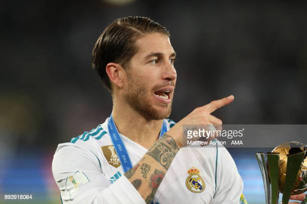 Sergio Ramos of Real Madrid celebrates with the trophy at the end of the FIFA Club World Cup UAE 2017 final match between Gremio and Real Madrid CF...