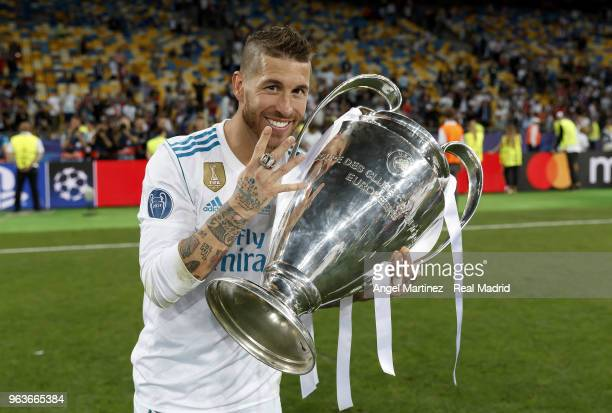 Sergio Ramos of Real Madrid celebrates with The UEFA Champions League trophy following his sides victory in the UEFA Champions League Final between...