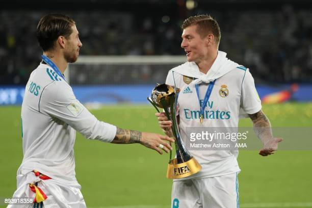Sergio Ramos of Real Madrid celebrates with Toni Kroos at the end of the FIFA Club World Cup UAE 2017 final match between Gremio and Real Madrid CF...