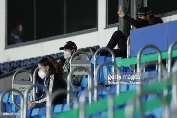 Sergio Ramos of Real Madrid CF and his teammate Eden Hazard attend from the grandstands the La Liga Santander match between Real Madrid and Real...
