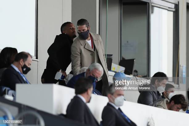 Sergio Ramos of Real Madrid CF and his teammate Eder Gabriel Militao attend from the grandstands the La Liga Santander match between Real Madrid and...
