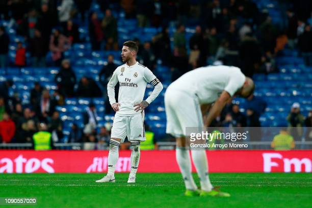 Sergio Ramos of Real Madrid CF and his teammate Karim Benzema react as he leaves the pitch after losing the La Liga match between Real Madrid CF and...