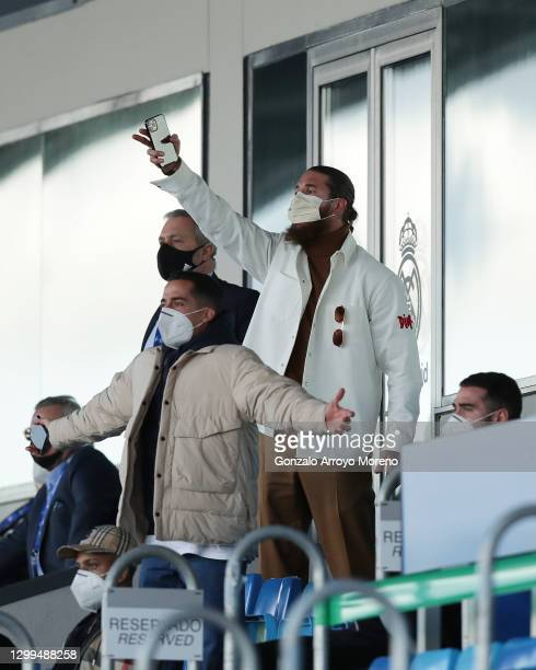 Sergio Ramos of Real Madrid CF and his teammate Lucas Vazquez protest to the referee from the grandstands during the La Liga Santander match between...