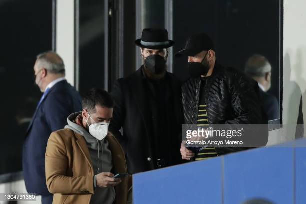 Sergio Ramos of Real Madrid CF and his teammates Karim Benzema and Daniel Carvajal attend from the grandstands the La Liga Santander match between...