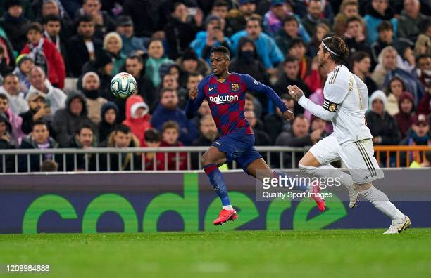 Sergio Ramos of Real Madrid CF battle for the ball with Nelson Semedo of FC Barcelona during the Liga match between Real Madrid CF and FC Barcelona...