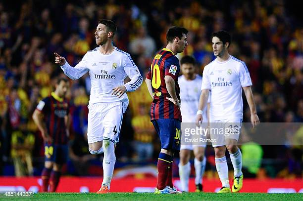 Sergio Ramos of Real Madrid CF celebrates past Lionel Messi of FC Barcelona after his teammate Gareth Bale of Real Madrid CF scored the winning goal...