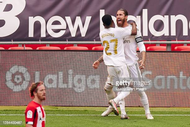 Sergio Ramos of Real Madrid CF celebrates with Rodrygo after scoring his team's first goal during the Liga match between Athletic Club and Real...
