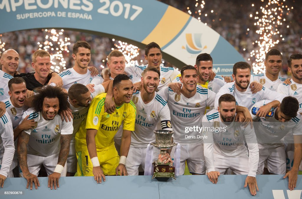 Sergio Ramos of Real Madrid CF celebrates with teammates with the Supercopa de Espana trophy after beating FC Barcelona 2-0 (3-1) on aggregate in the Supercopa de Espana Final 2nd Leg match between Real Madrid and FC Barcelona at Estadio Santiago Bernabeu on August 16, 2017 in Madrid, Spain.