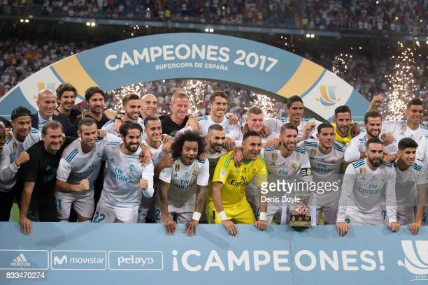 Sergio Ramos of Real Madrid CF celebrates with teammates with the Supercopa de Espana trophy after beating FC Barcelona 20 on aggregate in the...