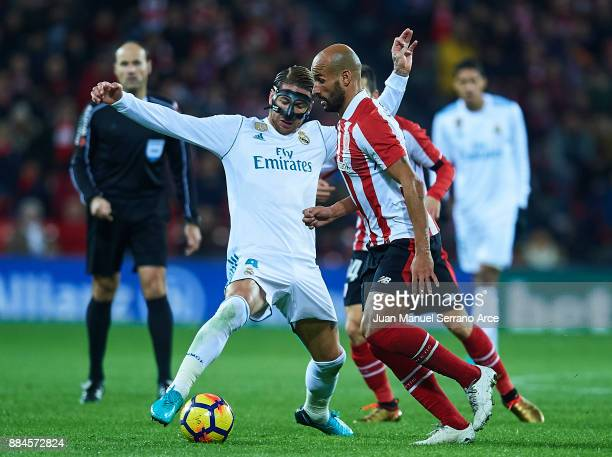 Sergio Ramos of Real Madrid CF competes for the ball with Mikel Rico of Athletic Club during the La Liga match between Athletic Club and Real Madrid...