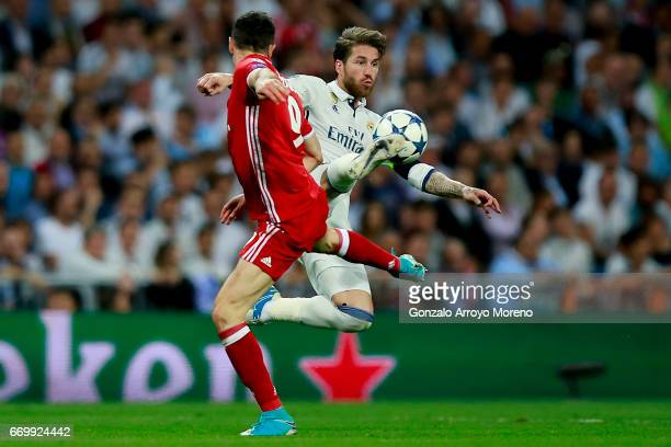 Sergio Ramos of Real Madrid CF competes for the ball with Robert Lewandowski of Bayern Muenchen during the UEFA Champions League Quarter Final second...