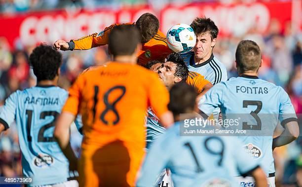 Sergio Ramos of Real Madrid CF duels for the ball with Aurtenetxe of RC Celta De Vigo during the la Liga match between Real Club Celta De Vigo and...
