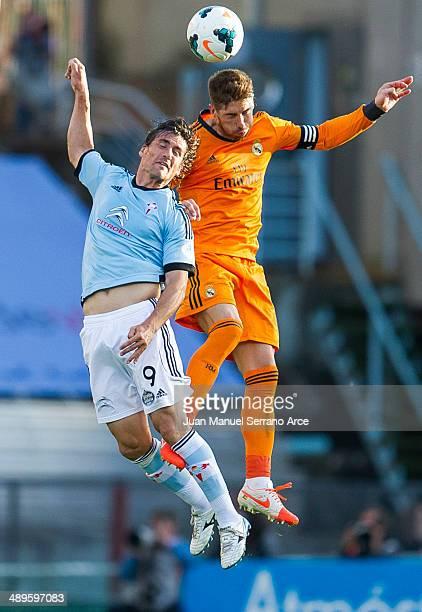 Sergio Ramos of Real Madrid CF duels for the ball with Mario Bermejo of RC Celta De Vigo during the la Liga match between Real Club Celta De Vigo and...