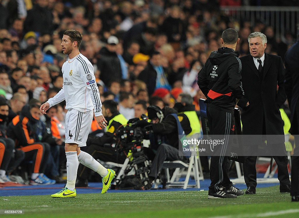 Sergio Ramos of Real Madrid CF leaves the field after being sent off with a red card while his head coach Carlo Ancelotti looks on during the UEFA Champions League group B match between Real Madrid CF and Galatasaray AS at Estadio Santiago Bernabeu on November 27, 2013 in Madrid, Spain.