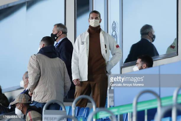 Sergio Ramos of Real Madrid CF leaves the grandstands surrounded by his teammates Rodrygo Goes , Lucas Vazquez and Daniel Carvajal after loosing the...