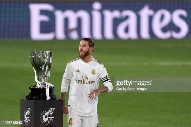 Sergio Ramos of Real Madrid CF looks on by the Spanish league trophy during the La Liga match between Real Madrid CF and Villarreal CF at Estadio...