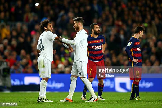 Sergio Ramos of Real Madrid CF passes the captain's armband to Marcelo of Real Madrid CF after receiving a red card during the La Liga match between...