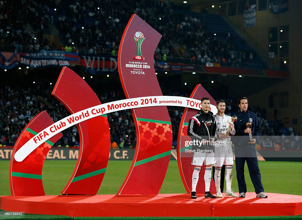 MVP Sergio Ramos of Real Madrid CF poses with Cristiano Ronaldo of Real Madrid CF (2nd) and Ivan Vicelich of Auckland City (3rd) after the FIFA Club World Cup Final match between Real Madrid CF and San Lorenzo at Le Grand Stade de Marrakech on December 20, 2014 in Marrakech, Morocco.