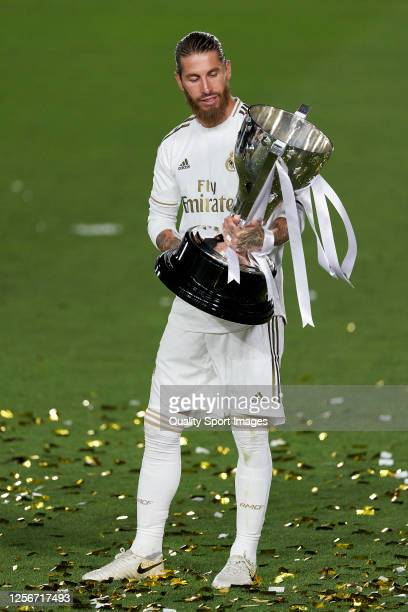 Sergio Ramos of Real Madrid CF posing with the La Liga trophy after Real Madrid secure the La Liga title during the La Liga match between Real Madrid...