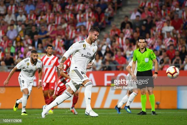 Sergio Ramos of Real Madrid CF scores his team's first goal from the penalty spot during the La Liga match between Girona FC and Real Madrid CF at...