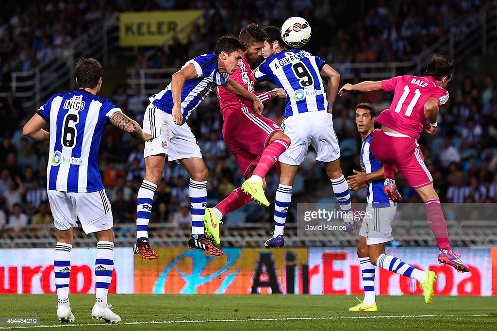 Sergio Ramos (C) of Real Madrid CF scores the opening goal during the La Liga match between Real Sociedad de Futbol and Real Madrid CF at Estadio Anoeta on August 31, 2014 in San Sebastian, Spain.