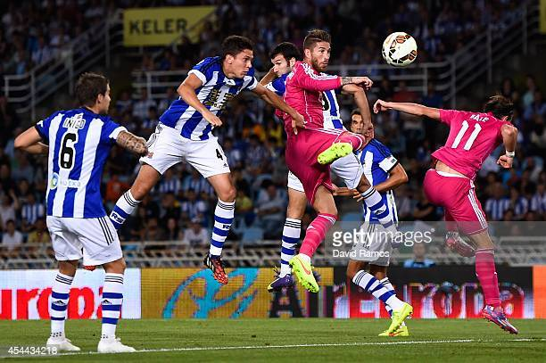Sergio Ramos of Real Madrid CF scores the opening goal during the La Liga match between Real Sociedad de Futbol and Real Madrid CF at Estadio Anoeta...