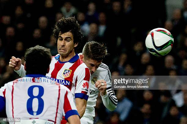 Sergio Ramos of Real Madrid CF scores their opening goal from a header behind Tiago Mendes of Atletico de Madrid during the Copa del Rey Round of 16...