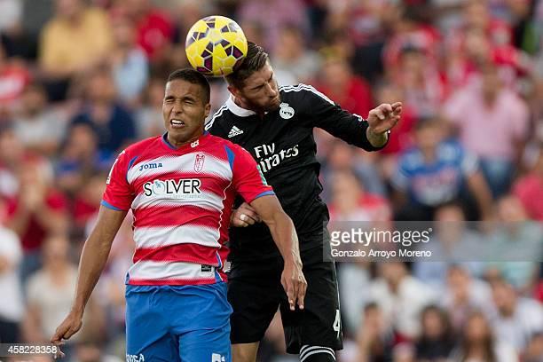Sergio Ramos of Real Madrid CF wins the header before Youssef ElArabi of Granada CF during the La Liga match between Granada CF and Real Madrid CF at...