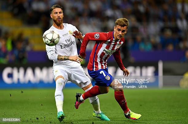 Sergio Ramos of Real Madrid challenges Antoine Griezmann of Atletico Madrid during the UEFA Champions League Final between Real Madrid and Club...