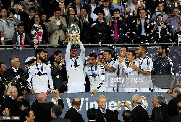 Sergio Ramos of Real Madrid collects the trophy after winning the UEFA Super Cup Final between Real Madrid and Sevilla at the Cardiff City Stadium in...