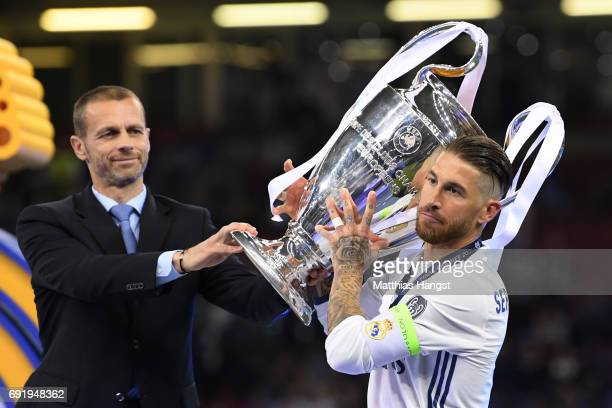 Sergio Ramos of Real Madrid collects the trophy from UEFA President Aleksander Ceferin after the UEFA Champions League Final between Juventus and...
