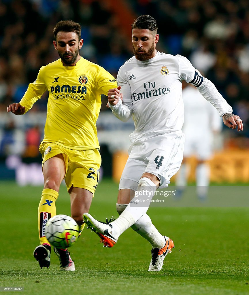 Sergio Ramos of Real Madrid competes for the ball with Adrian Lopez of Villarreal during the La Liga match between Real Madrid CF and Villarreal CF at Estadio Santiago Bernabeu on April 20, 2016 in Madrid, Spain.