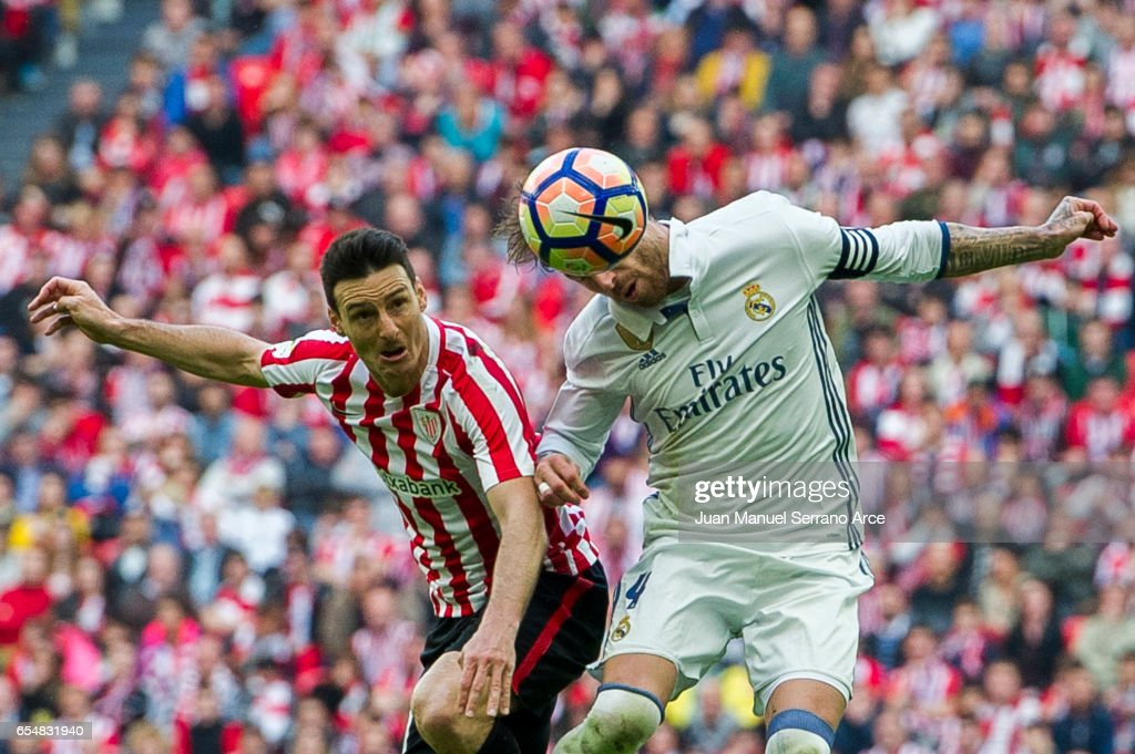 Sergio Ramos of Real Madrid competes for the ball with Aritz Aduriz of Athletic Club during the La Liga match between Athletic Club Bilbao and Real Madrid at San Mames Stadium on on March 18, 2017 in Bilbao, Spain.