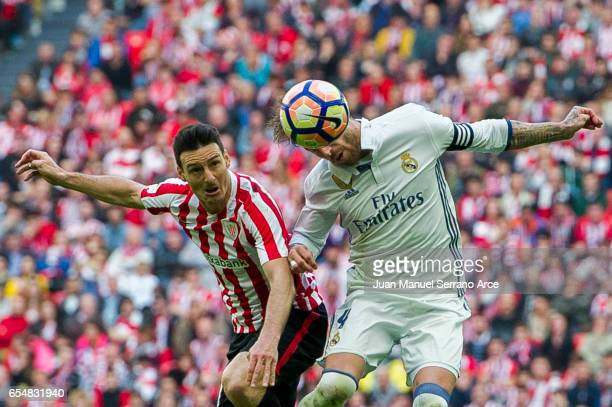 Sergio Ramos of Real Madrid competes for the ball with Aritz Aduriz of Athletic Club during the La Liga match between Athletic Club Bilbao and Real...