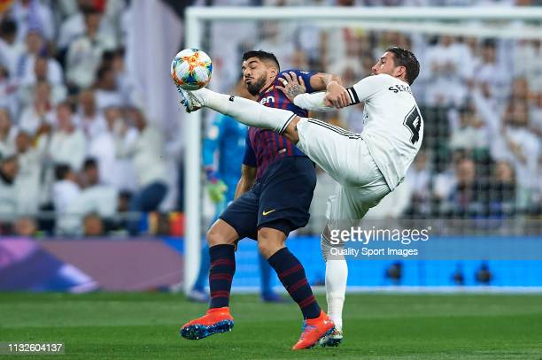 Sergio Ramos of Real Madrid competes for the ball with Luis Suarez of Barcelona during the Copa del Rey Semi Final second leg match between Real...