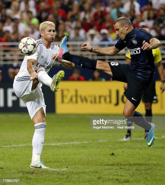 Sergio Ramos of Real Madrid competes for the ball with Rodrigo Palacio of Inter Milan during the preseason friendly match between Real Madrid CF and...