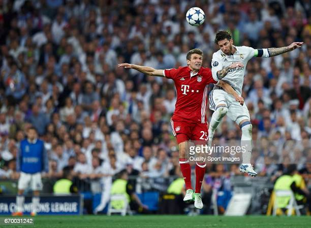 Sergio Ramos of Real Madrid competes for the ball with Thomas Muller of Bayern Muenchen during the UEFA Champions League Quarter Final second leg...