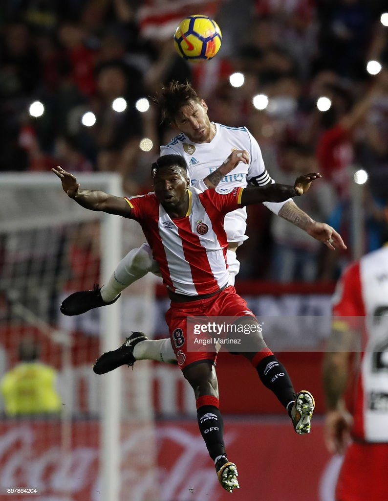 Sergio Ramos of Real Madrid competes for the ball with Tobi Kayode of Girona during the La Liga match between Girona and Real Madrid at Estadi de Montilivi on October 29, 2017 in Girona, Spain.