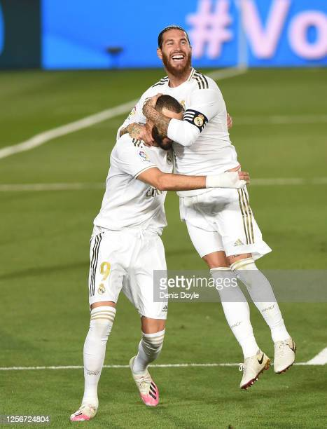 Sergio Ramos of Real Madrid congrtatulates Karim Benzema after Benzema scored the second goal from a penalty during the Liga match between Real...