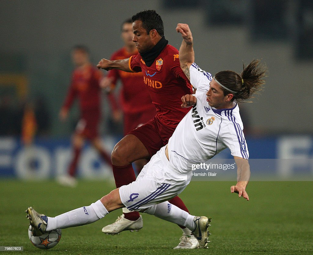 Sergio Ramos of Real Madrid contests with Mancini of AS Roma during the UEFA Champions League first knockout round, first leg match between AS Roma and Real Madrid at the Olympic Stadium February 19, 2008 in Rome, Italy.