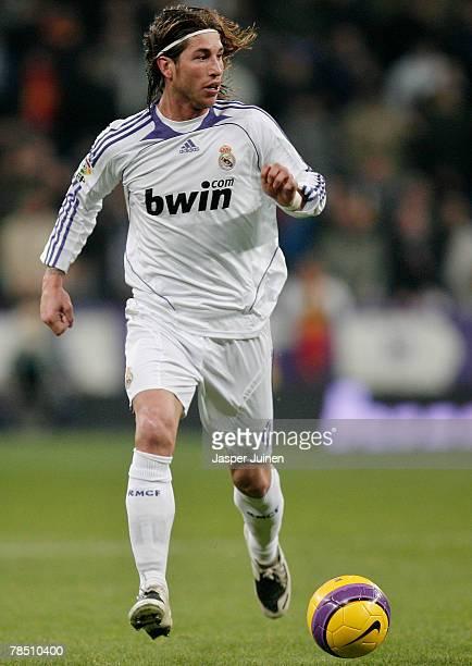 Sergio Ramos of Real Madrid controls the ball during the La Liga match between Real Madrid and Osasuna at the Santiago Bernabeu Stadium on December...