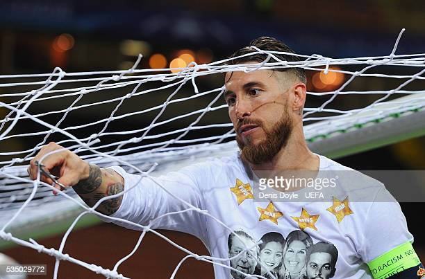 Sergio Ramos of Real Madrid cuts the net after winning the UEFA Champions League Final between Real Madrid and Club Atletico de Madrid at Stadio...