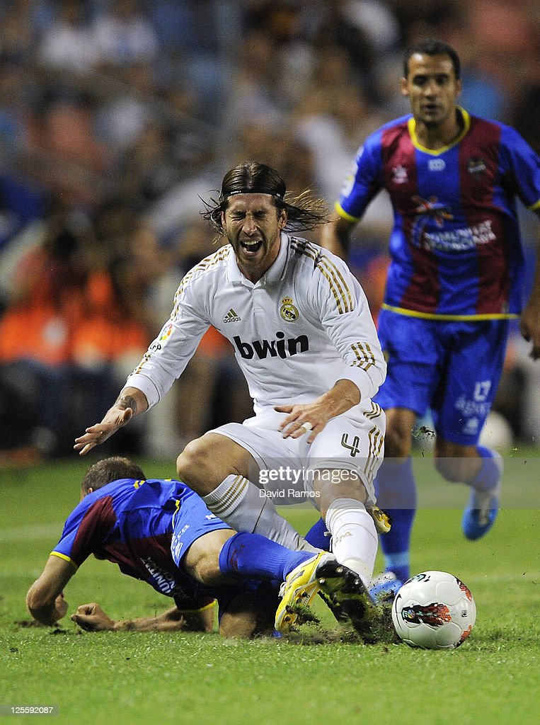 Sergio Ramos of Real Madrid duels for the ball with Juan Luis Gomez of Levante UD during the La Liga match between Levante UD and Real Madrid CF at Ciutat de Valencia Stadium on September 18, 2011 in Valencia, Spain. Levante UD won 1-0.