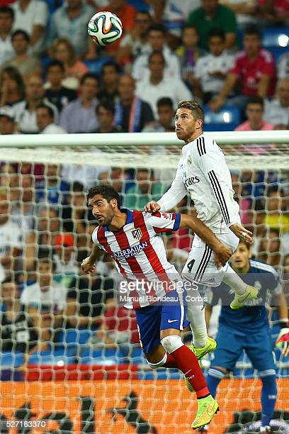 Sergio Ramos of Real Madrid duels for the ball with Raul Garcia of Atletico de Madrid during the Spanish Supercup first leg football match Real...