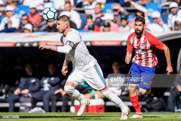 Sergio Ramos of Real Madrid fights for the ball with Diego Costa of Atletico de Madrid during the La Liga match between Real Madrid and Atletico...
