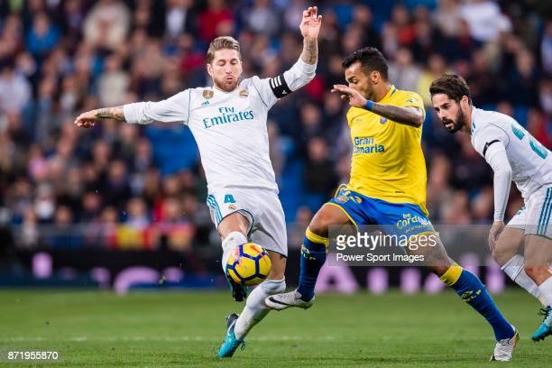 Sergio Ramos of Real Madrid fights for the ball with Joaquin Navarro Jimenez Ximo of UD Las Palmas during the La Liga 201718 match between Real...