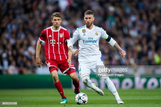 Sergio Ramos of Real Madrid fights for the ball with Thomas Muller of FC Bayern Munich during the UEFA Champions League Semi Final Second Leg match...