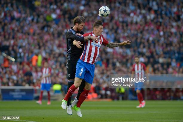 Sergio Ramos of Real Madrid figths the ball with Fernando Torres of Atletico de Madrid during a match between Club Atletico de Madrid and Real Madrid...