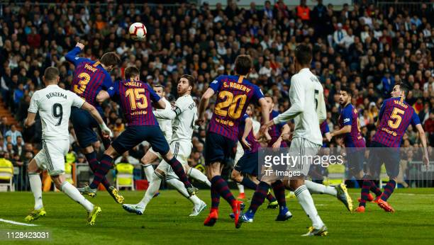 Sergio Ramos of Real Madrid Gerard Pique of Barcelona and Lenglet of Barcelona battle for the ball during the La Liga match between Real Madrid CF...