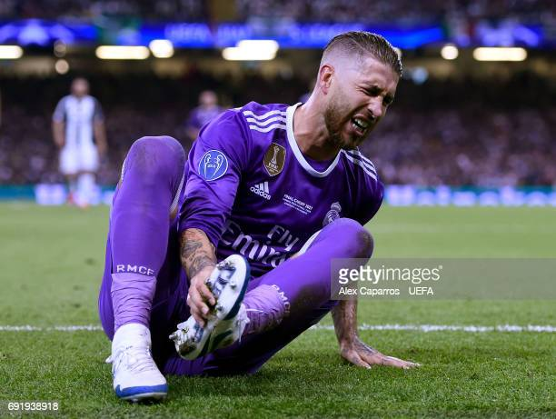 Sergio Ramos of Real Madrid goes down in pain during the UEFA Champions League Final between Juventus and Real Madrid at National Stadium of Wales on...